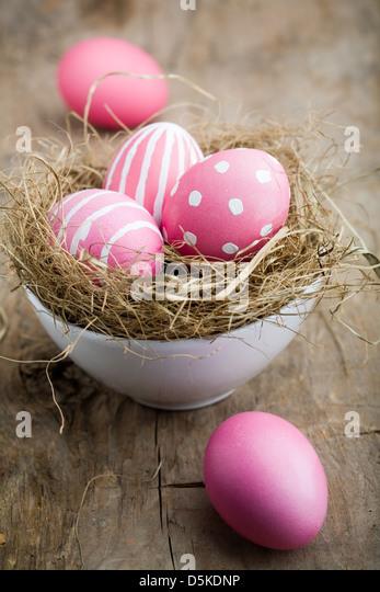 Painted easter egg in little bird nest - Stock Image