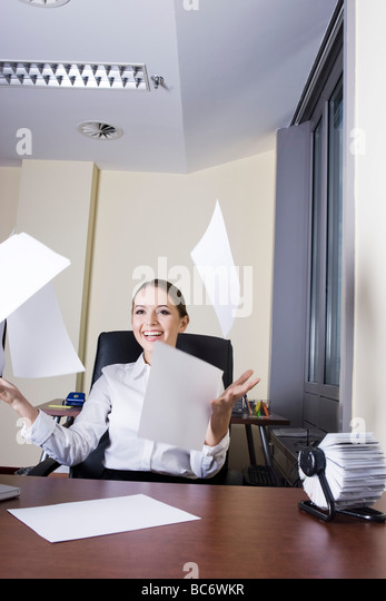 Joyful woman in the office - Stock Image