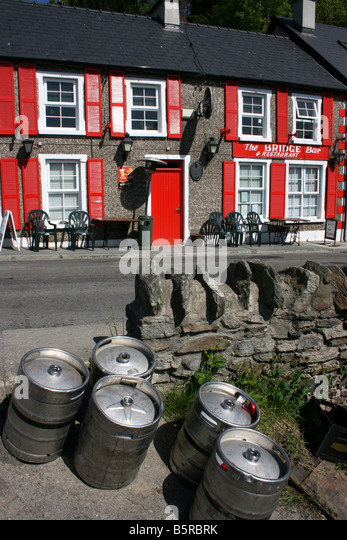 The Bridge Bar, pretty Irish pub in town of Ramelton, County Donegal, Ireland - Stock Image