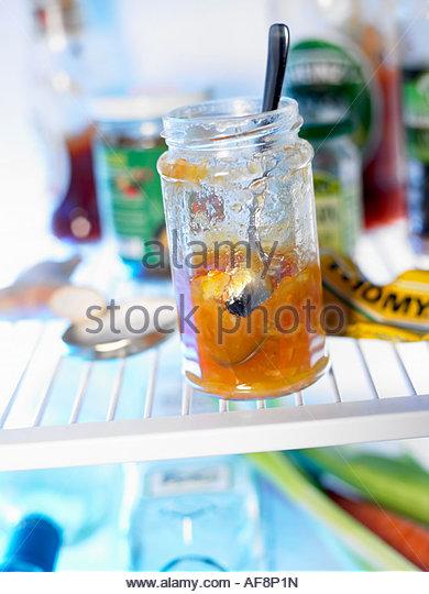 Various tinned foods in fridge - Stock Image