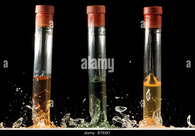 Three test tubes breaking on impact - Stock Image