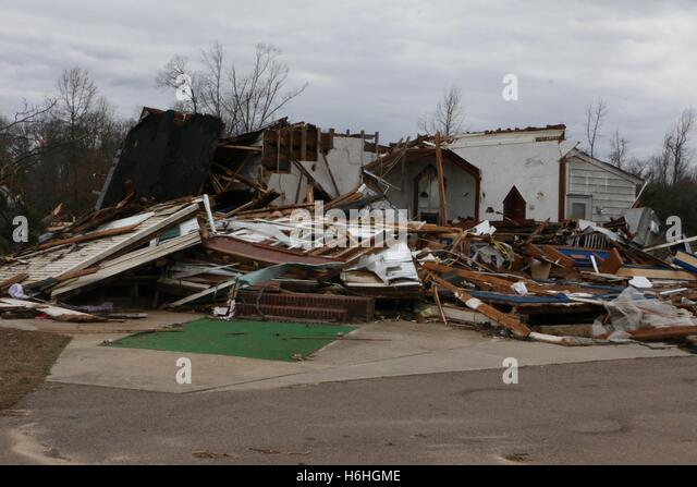 Debris from a destroyed house blocks a road after a severe storm and tornado February 25, 2016 in Essex County, - Stock Image