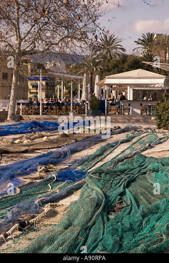 Mallorca fisher nets at port background seafood and tapa restaurant - Stock Image