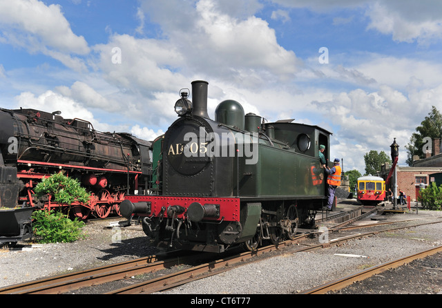 Steam trains at the depot of the Chemin de Fer à Vapeur des Trois Vallées at Mariembourg, Belgium - Stock Image
