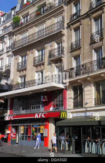 Paris France Europe French 8th 9th 17th 18th arrondissement Place de Clichy KFC McDonald's fast food restaurant - Stock Image
