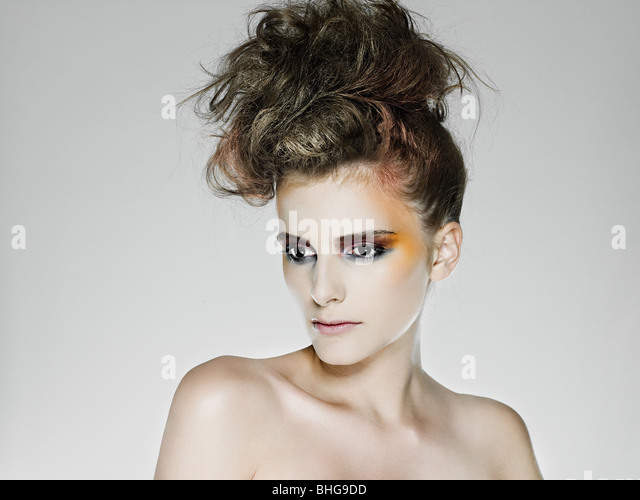 Young woman with bright makeup - Stock Image