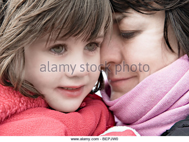 Woman mothering a child - Stock Image