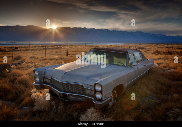 Abandoned Chevrolet automobile in field near Mount Whitney near Lone Pine in California USA - Stock Image