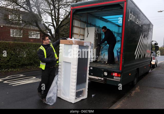 John Lewis Delivering A Freezer Man Unpacking Freezer By Lorry England - Stock Image