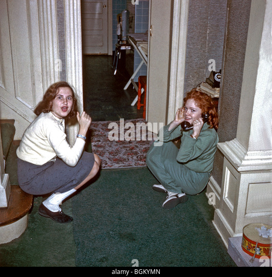 NEW JERSEY, U.S.A. - Teenage Girls on Telephone at Home, in the 1950's., Family Photo Archives - Stock Image