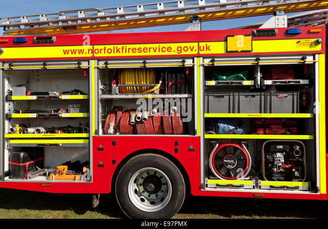 A fire engine appliance displaying equipment carried on board - Stock Image