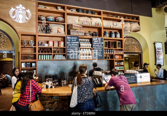 Mumbai India Indian Asian Fort Mumbai Kala Ghoda Veer Nariman Road Elphinstone Building Starbucks Coffee cafe inside - Stock Image