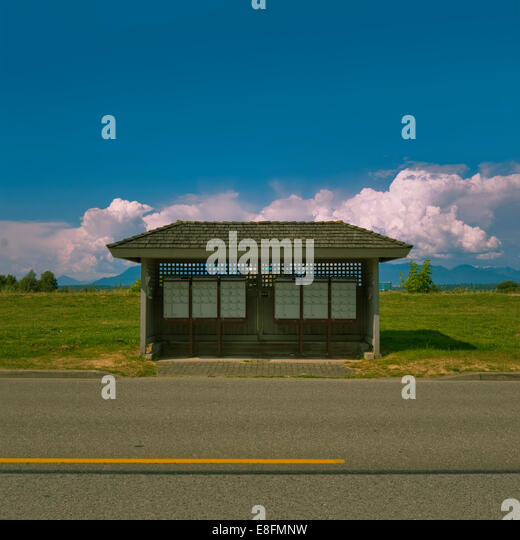 View of bus stop and mail boxes - Stock Image