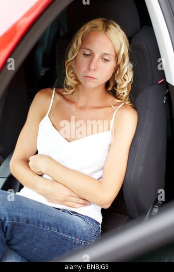 Girl with travel sickness - Stock-Bilder