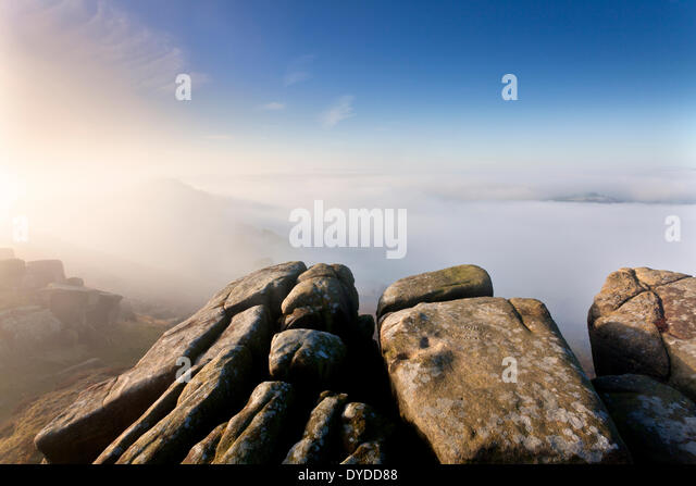 A misty autumnal morning on Curbar Edge looking towards Baslow Edge. - Stock Image