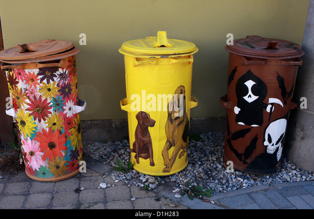 artistically painted bins - Stock-Bilder