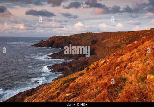 Looking towards Pendeen lighthouse and watch on the Cornish coastline, Cornwall, England, United Kingdom, Europe - Stock Image
