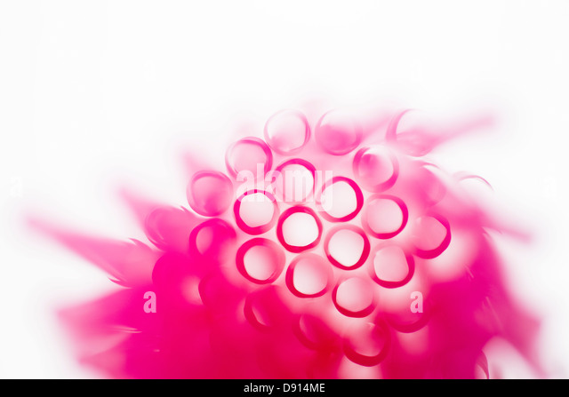 Studio shot of pink drinking straws - Stock Image