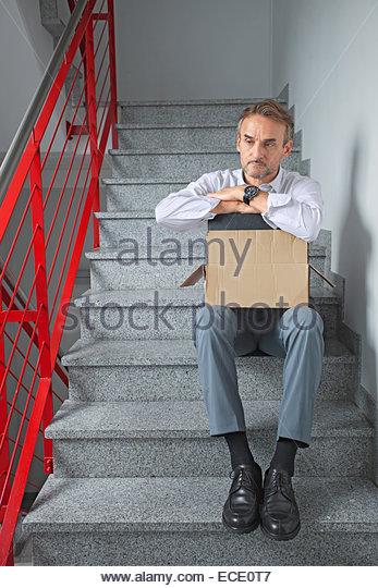 Businessman alone depressed jobless homeless - Stock Image