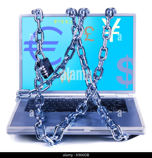 Chains wrapped around laptop depicting currency symbols - Stock Image