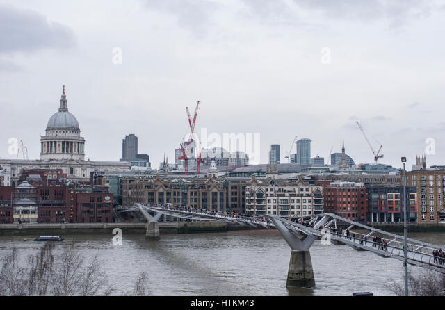 View of St Paul's Cathedral and the City of London and London Millenium Bridge from the Tate Gallery balcony - Stock Image