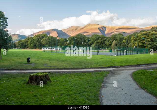 Fitz Park,Keswick showing the cricket pavillion and play areas with the imposing Skiddaw in the background - Stock Image