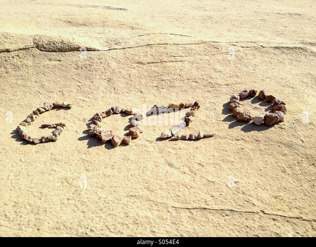 Gozo name spelt out with limestone rocks. - Stock Image