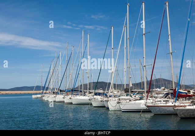 Yachts moored in Alghero, north Sardinia - Stock Image
