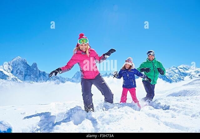 Family playing in snow, Chamonix, France - Stock-Bilder