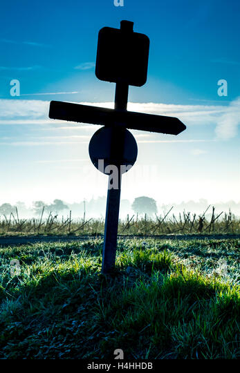 Silhouette of roadsigns - France. - Stock Image