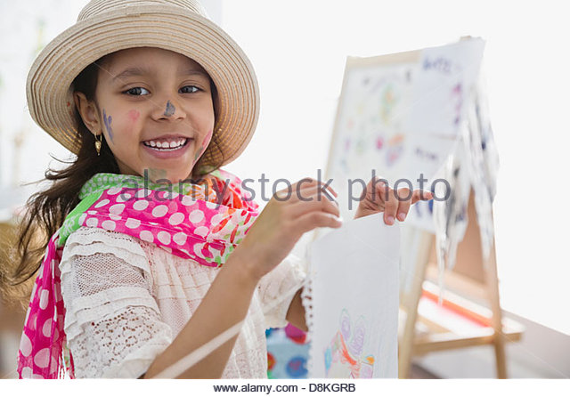 Portrait of girl pretending to be artist - Stock Image