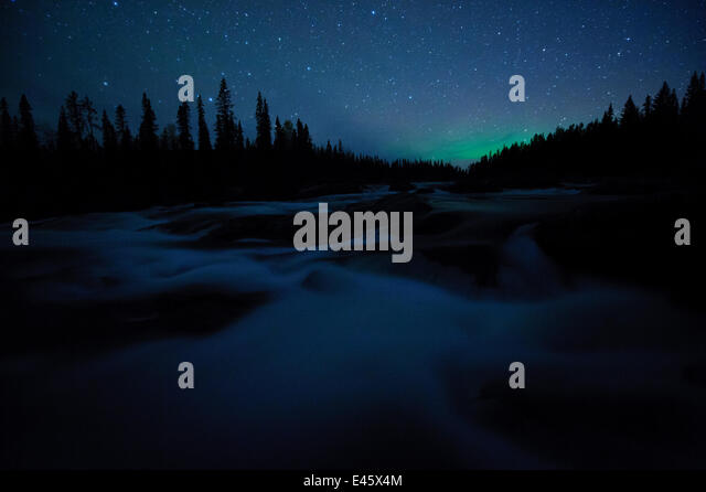 Northern lights far on the horizon in night landscape. Sarek National Park, Sweden, Europe, September. - Stock Image