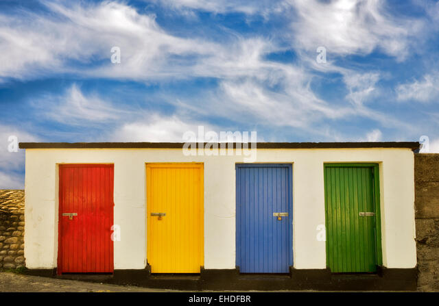 Colored doors. Inishfree Pier, Ennicrone, Ireland - Stock Image