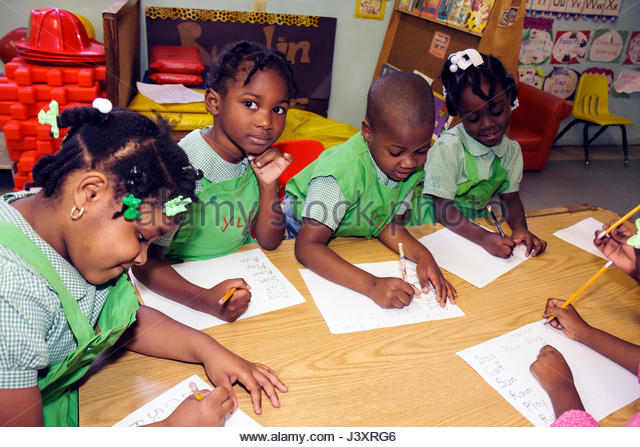 Miami Florida Little Haiti Yvonne Learning Center private Christian school education class student Black boy girl - Stock Image