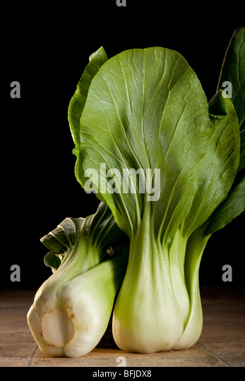 Bok Choy (Chinensis) - In Cantonese means literally white vegetable. It has succulent white stems with dark green - Stock Image
