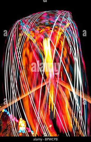 Bright abstract light painting at night from the FireBall ride at the Toronto CNE fair - Stock Image
