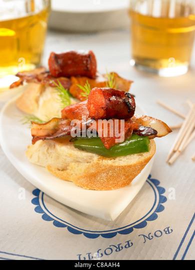 Chorizo and bacon open sandwich - Stock Image