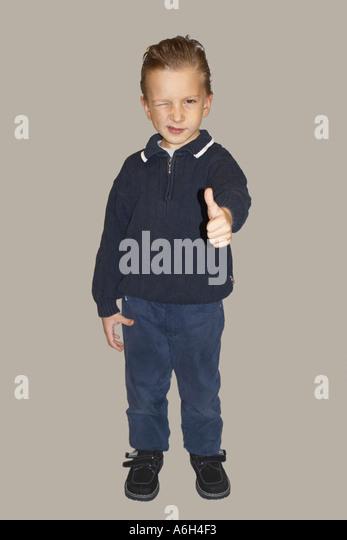 Friendly kid poses in studio - Stock Image
