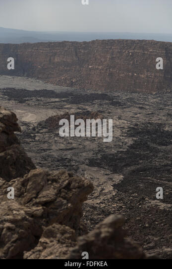 An older volcanic cone lies almost buried in new lava flows in the Erta Ale caldera, Ethiopia - Stock Image
