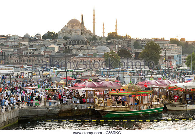 Waterfront at Eminonu with the Rustem Pasha Mosque on the skyline, Istanbul, Turkey - Stock Image