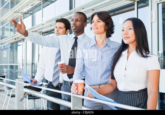 Business people on indoor balcony - Stock Image