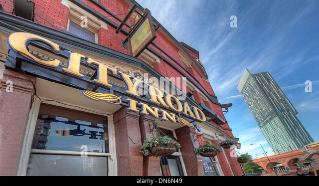 The City Road inn Pub Manchester with Hilton Hotel in background Lancashire England UK - Stock Image