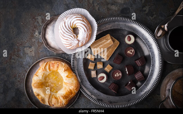 Candy, cake and coffee on a gray stone horizontal - Stock Image