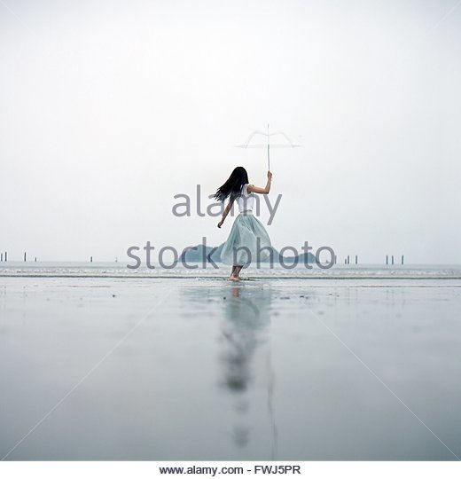 Rear View Of A Girl Holding Bow - Stock Image