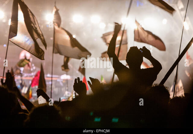 Flags and crowd at Pyramid Stage during headlining performance at Glastonbury Festival/ 'Glasto' held on - Stock Image