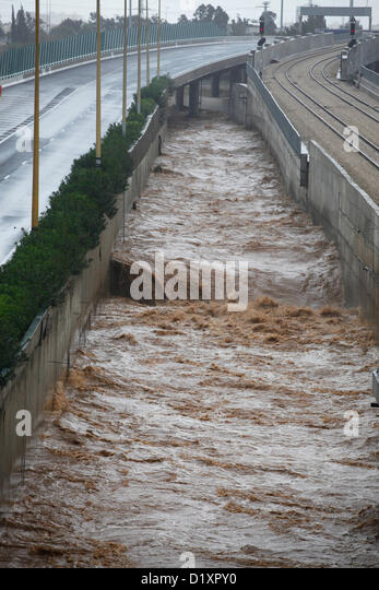 River overflows onto Tel Aviv's main artery, Ayalon Highway, causing mass closures and its main traffic artery - Stock Image