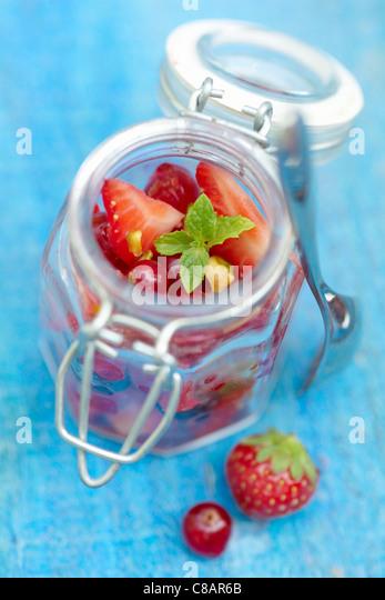 Open jar of summer fruit - Stock Image