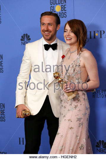 Ryan Gosling and Emma Stone pose with their awards for Best Performance by an Actor in a Motion Picture - Musical - Stock Image