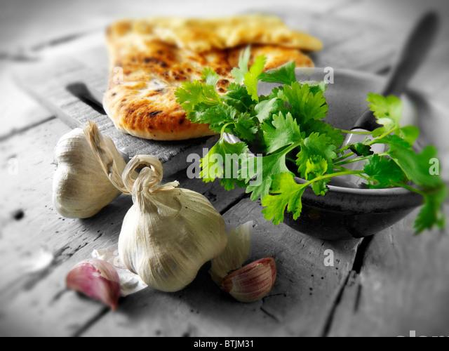 Corriander and Garlic Indian Naan bread - Stock Image