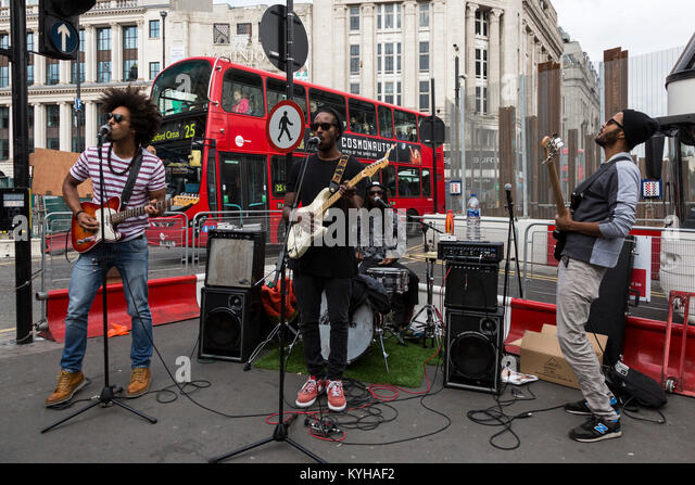 Band The Thirst busking in Oxford Street, London - Stock Image